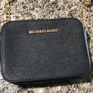 New without tags Michael Kors side body purse.
